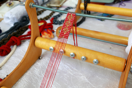 Details of Bead Weaving Machine on table
