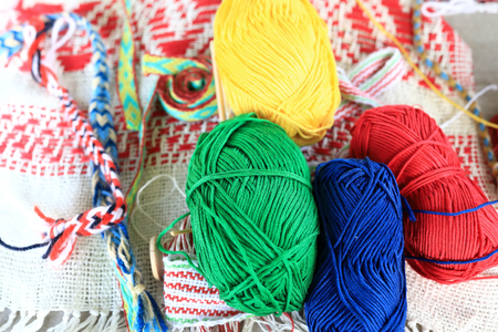 Skeins of yarn on a market counter