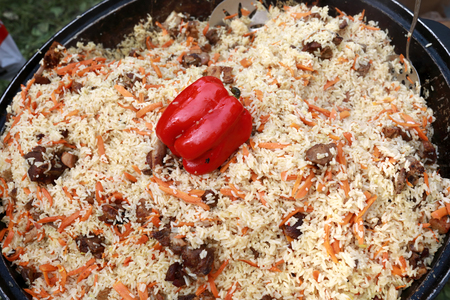 Pilaf cooked in a cauldron on picnic Foto de archivo