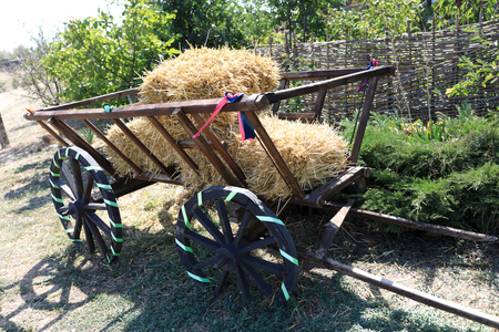 Decorated wooden cart with straw at farm