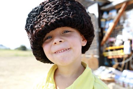 Portrait of child in Russian Karakul Kubanka Cossack Hat