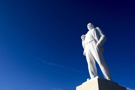 View of White Monument Lenin on sky background