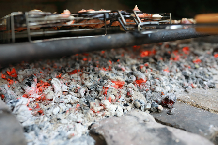 Details of burning coals in barbecue on picnic