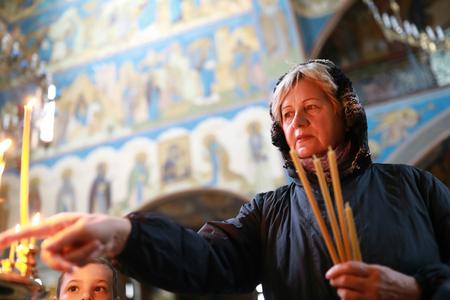 Portrait of senior woman in orthodox church
