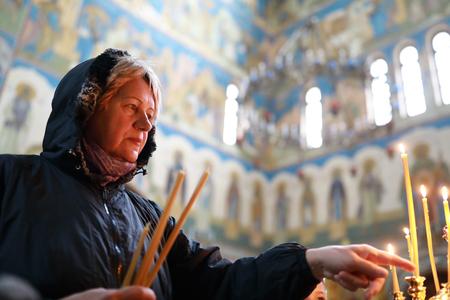 Portrait of elderly woman in orthodox church