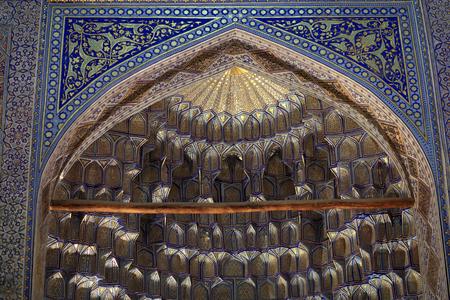 Deep niches and diverse muqarnas decoration in Guri Amir. It is mausoleum of the Asian conqueror Tamerlane in Samarkand, Uzbekistan