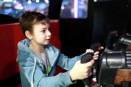 Child playing toy gun in amusement park