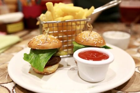 Burgers with french fries and ketchup in restaurant