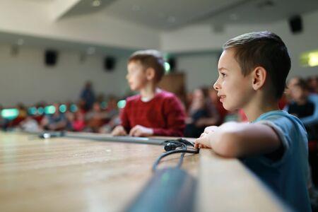 Children in the theater near the stage 版權商用圖片