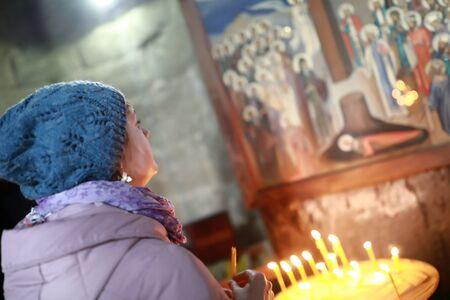 Woman looking at icon in Georgian Orthodox Church Stock Photo