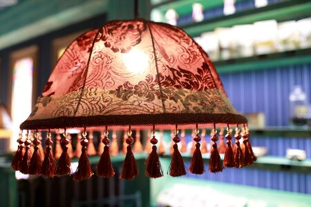 View of lampshade with tassels in cafe