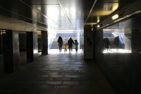 Family crosses an underpass in Moscow city Banque d'images