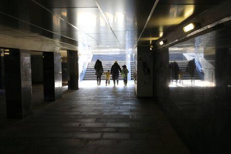 Family crosses an underpass in Moscow city Zdjęcie Seryjne