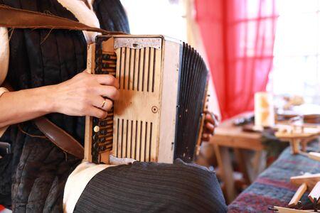 Man plays retro accordion at fair, Russia