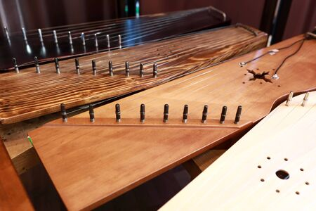 View of ancient Russian instruments of harp on table