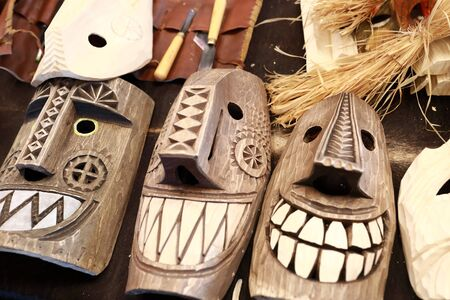Wooden mummer masks on counter at market
