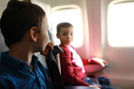 Portrait of two boys in a passenger plane