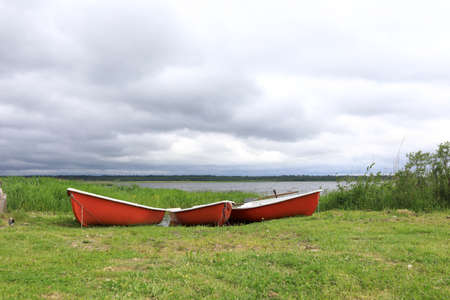 View of boat on estuary of Lake Seliger after rain