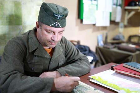 Portrait of man in uniform of Wehrmacht soldier at desk