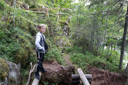 Child posing in summer forest, Karelia, Russia