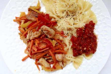 Pasta with turkey stew and adjika sauce on plate Imagens