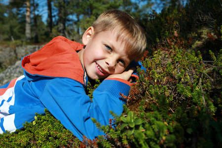 Child lying on moss, Ladoga skerries, Karelia