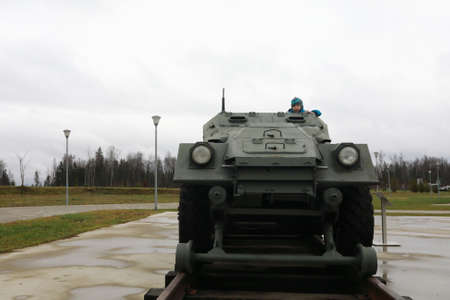 Child on railway armored personnel carrier BTR-40A, Russia