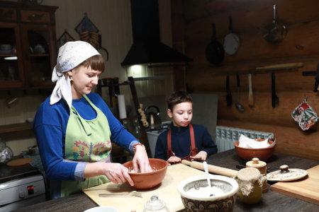 Cook making dough in bowl in kitchen Reklamní fotografie