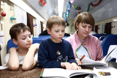 Family with menu in train carriage restaurant