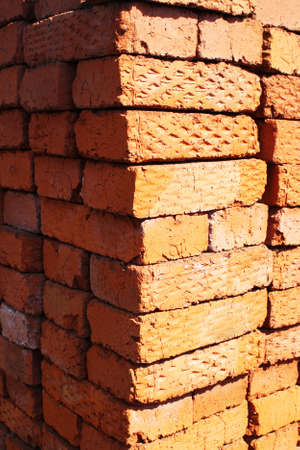 building material: Bricks laid by a stack, building material. Stock Photo
