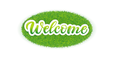 Lettering Welcome on the grass.