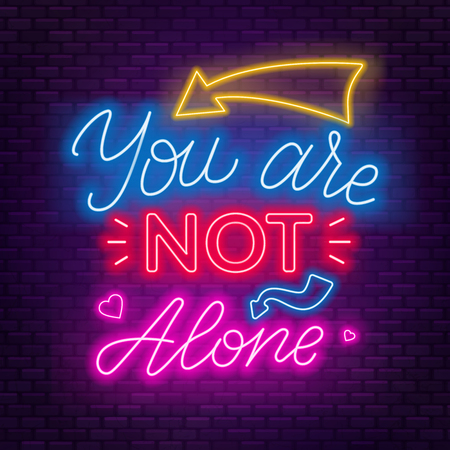 Neon lettering you re not alone. Motivational quote for people in difficult life situation.