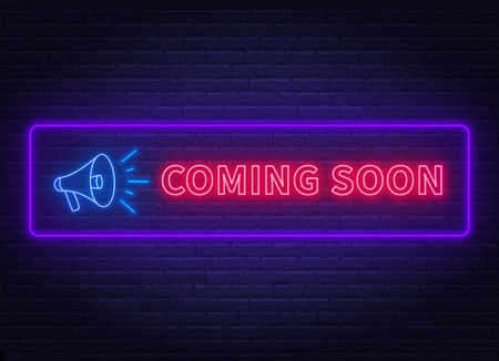 Coming soon neon sign with megaphone on a brick wall background.