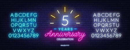 5th anniversary celebration neon sign on dark background.