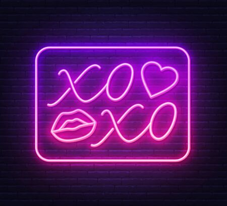 Neon sign xoxo with a kiss on a dark background.