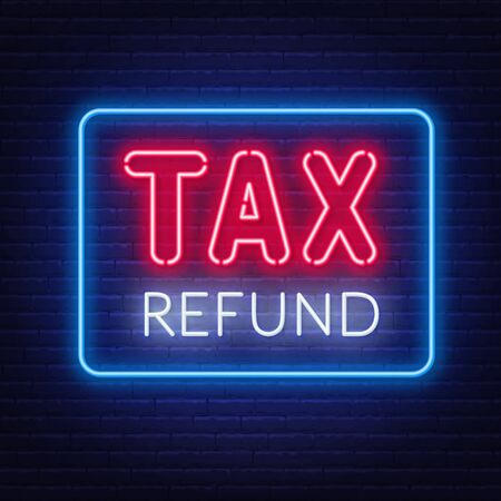 Tax refund neon sign on dark background.