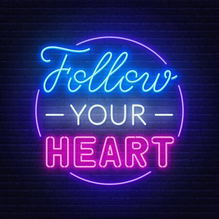 Follow your heart neon lettering on dark background.