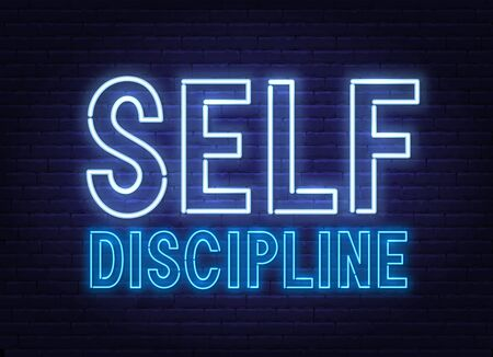 Self discipline neon sign on dark background.