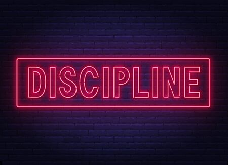 Discipline neon sign on dark background.