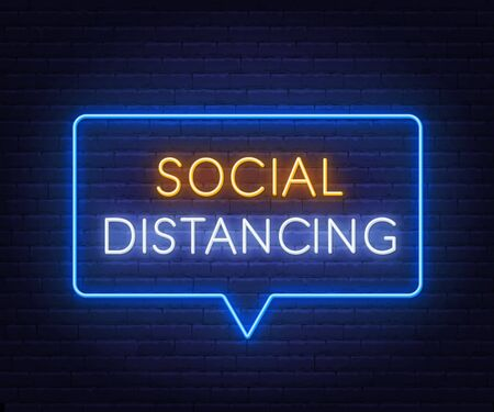 Social distancing neon sign on brick wall background.