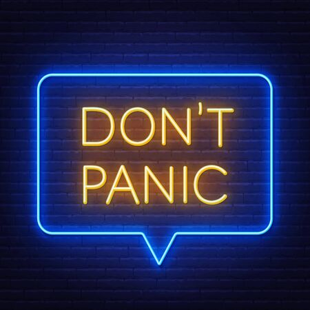 Dont panic neon sign on brick wall background.