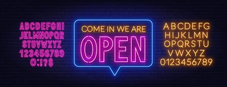 Come in we are open neon sign on brick wall background.