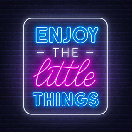 Enjoy the little things neon inspirational quote on a brick wall background.