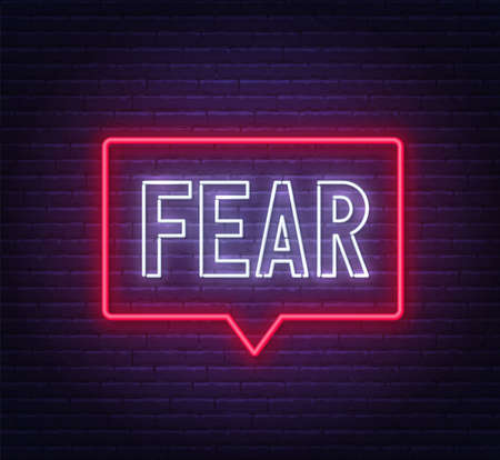 Fear neon sign on brick wall background.