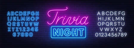 Trivia night neon sign on a brick wall.