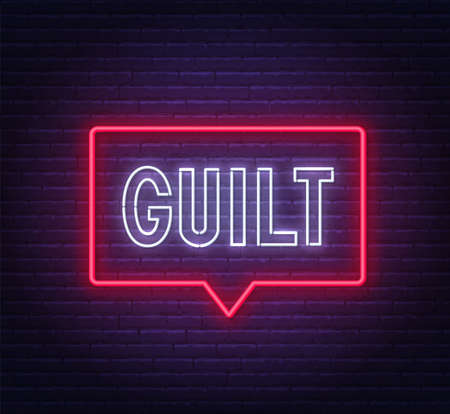 Guilt neon sign on brick wall background.