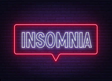 Insomnia neon sign on brick wall background.
