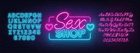 Sex Shop neon sign on brick wall background. 免版税图像