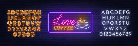 Love coffee neon sign on brick wall background.