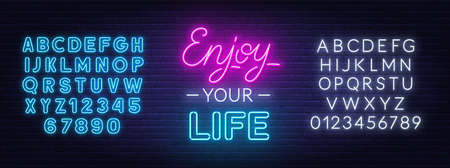 Enjoy Your Life neon lettering on brick wall background.